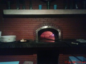 Commercial pizza ovens for cooking pizzas.