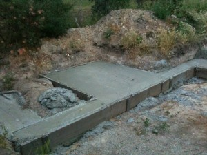 The pizza oven base slab as part of a whole wall.