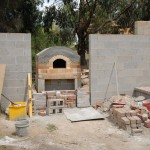 Concrete slab with concrete block wall on top.