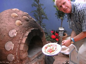 Pizza cooked in earth clay cob mud oven.