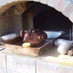 Leg of lamb roasted in Masterly Tail brick oven design.
