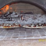 Greg cooked great pizza in his Masterly Tail brick oven.
