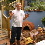 Mixing clay sand for building earth cob pizza oven.