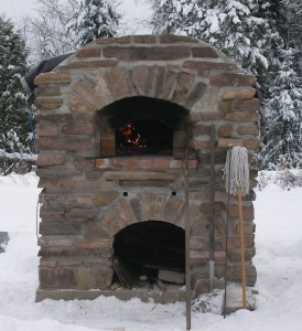 Oven with no roof and winter snow around the oven.
