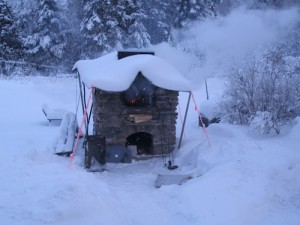 lots of snow on wood fired oven.