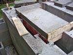 Angle iron in concrete.