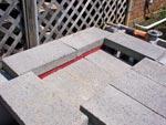 Angle iron pavers work.
