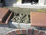 Building entry surface hearth and first decorative arch from house bricks.