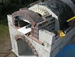Making flue hood with own arch and front arched decoration.