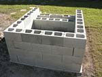 Raising block walls with dry stack cement blocks filled with concrete.