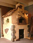 Image of a brick wood burning pizza oven.