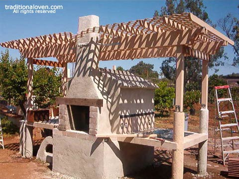 Building progress on wood burning oven by Tony.