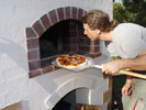 Pizza paddle used for placing pizzas in and out from the wood ovens.