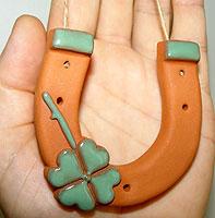 Picture of the horseshoe with four leaf clover, double good luck from traditionaloven.com