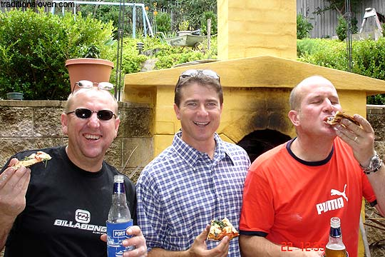3 Pizza Men friends and oven built in ground.