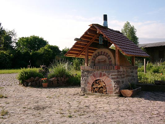 Clay mud adobe outdoor wood fire oven.