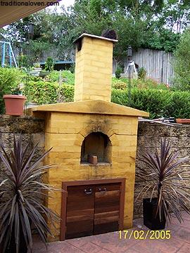 In ground oven built on split level garden backyard.