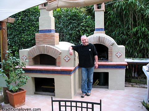 Photo of Italian forno wood fired pizza brick oven and fireplace.