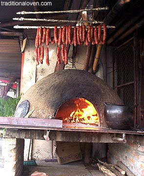 Smoked sausages on smoke from wood fire, picture.