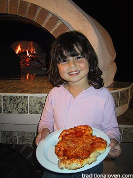 Picture of pizza made in wood oven by 4 year old Erika.