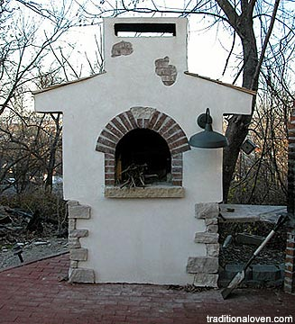 Plaster finish applied to outdoors brick oven.