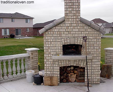 Picture of wood fired oven in backyard garden. Outdoor cooking project.
