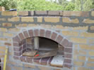 Picture of oven entry brick arch.