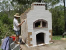 Build oven outside walls and paint them white.