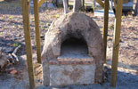 Picture of the garden wood burning oven built of bricks.