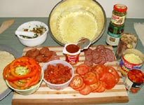 Ingredients used as toppings for a salami pizza.