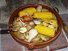 Picture of a roasted veggies in a wood fired oven.