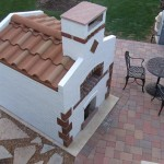 Tiled pizza oven roof.
