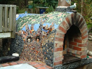Pizza oven with a beautiful tile mosaic decoration on.