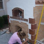 Painting our pizza oven walls.