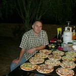 Cooking pizzas in igloo round pizza oven.