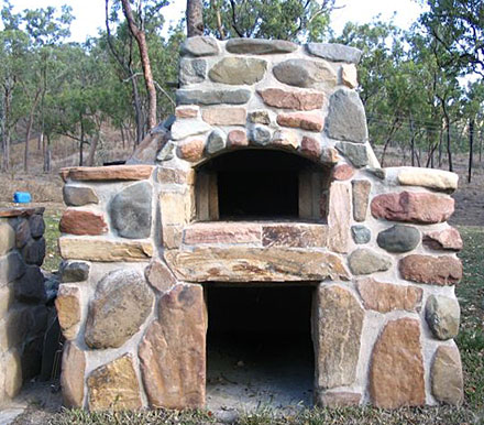 A river-rock on the oven's outside decoration.