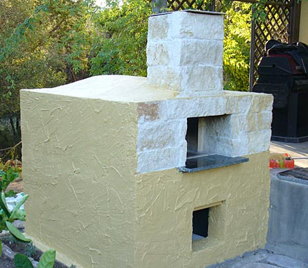 Stucco finish on the pizza oven.