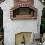 Smoker with brick pizza oven.