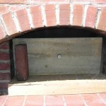 Wood meat smoker in brick oven.