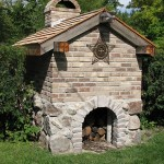 Back of a pizza oven with field stones.