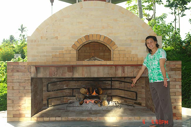 My brick oven & fireplace cook food and heat water