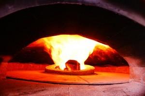 Gas burner in the oven's floor center.