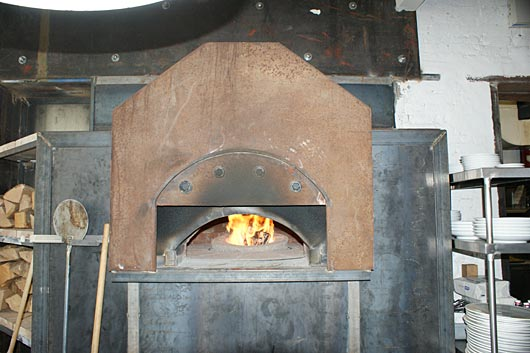 Gas Fire In Center With Revolving Stone