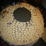 Constructing igloo firebricks pizza oven.