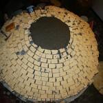 Constructing igloo firebricks pizza oven.