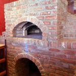 Pizza shops round cylindrical pizza oven.