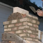 Making chimney capping on a pizza oven.