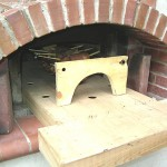 Smoking meat in brick oven.