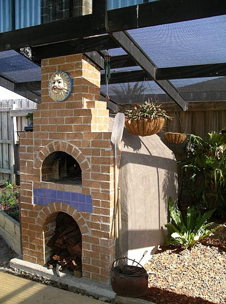 Pizza oven and kitchen both built outdoors.