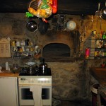 Oven with dome made out of stones in an old kitchen.